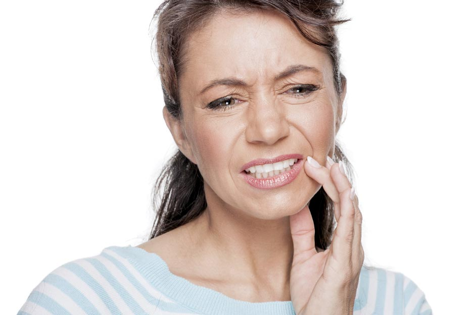 woman grimaces because of sensitive teeth